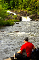 Man relaxing by the rapids