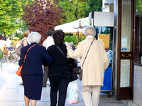 Three elderly women walking away