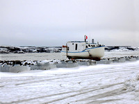 Boat on wood blocs out of the water during the winter season in Kuujjuaq, Nunavut