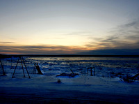 View of a children's play ground in Kuujjuaq at sundown